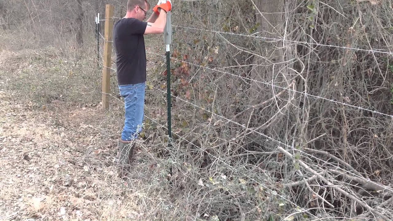 Pounding in T-Posts for Barbed Wire Fence - YouTube