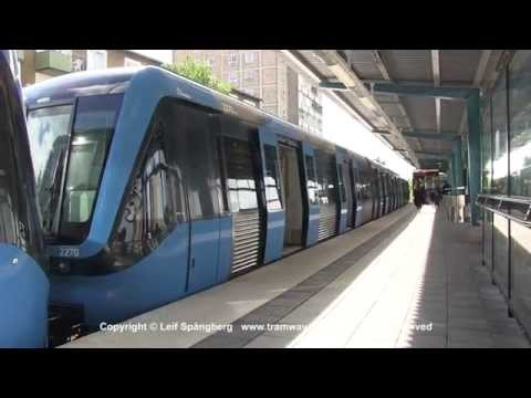 SL Tunnelbana tåg / Metro trains at Kärrtorp station, Stockholm, Sweden
