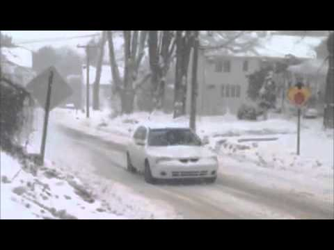 This driver can't get up a hill in Danbury as the snow picks up Thursday morning.
