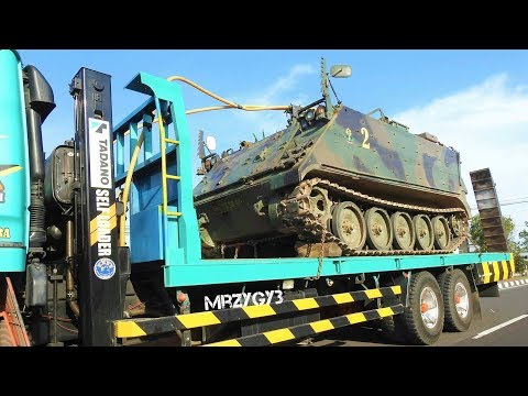 Military Vehicle Transported By Self Loader Truck With Polis