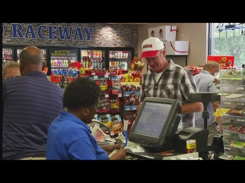 Locals line up for powerball tickets ahead of $758 million jackpot