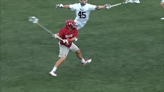 Shot from Harvard LSM Jack Breit breaks through the goalie's pocket