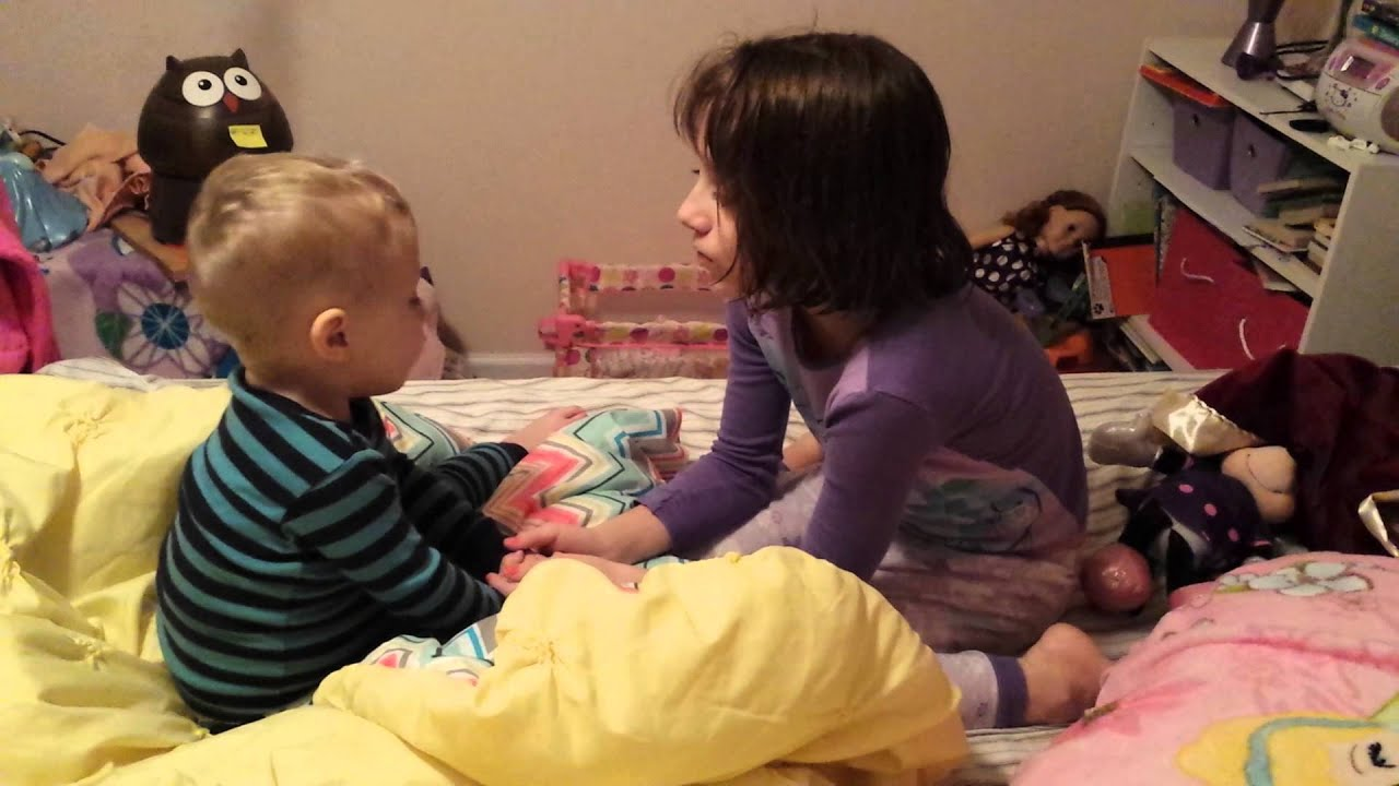 Sister teaches brother