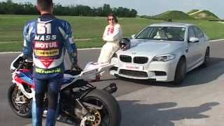 BMW M5 vs BMW S1000RR - Track Test by TopSpeed Magazine