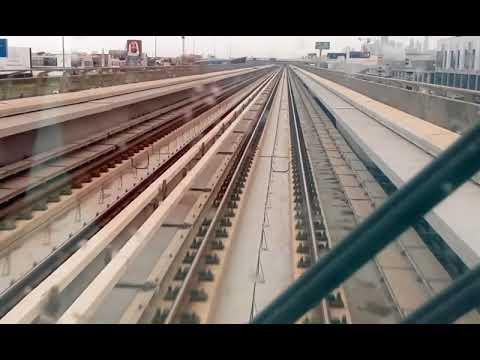 Dubai Metro Train Travelling Birendra in UAE