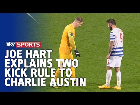 Joe Hart explains 'two kick' rule to Charlie Austin on the pitch after QPR v Man City