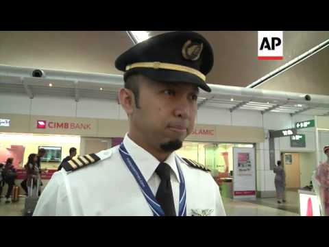 Pilot and passenger react to Flight 17 disaster, airport scenes