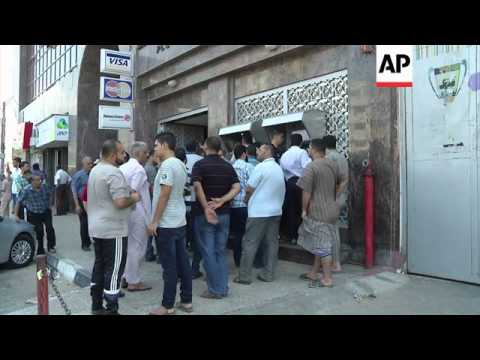 Palestinians take advantage of ceasefire to visit shops, banks