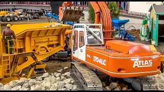 RC construction machine in 1:8 scale! Excavator Atlas and rock crusher in action!