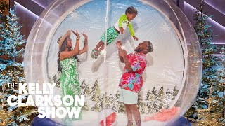 Watch This Family Take A Holiday Card Photo Inside A Human-Sized Snow Globe