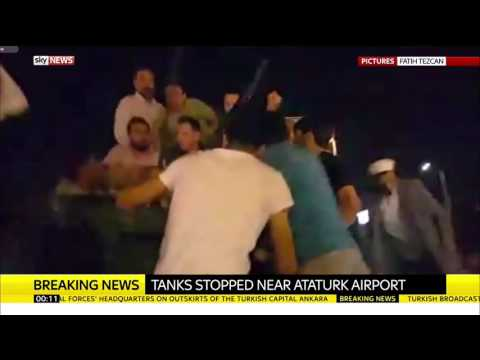 Turkey Protesters Climb Onto Tank Near Istanbul's Ataturk Airport