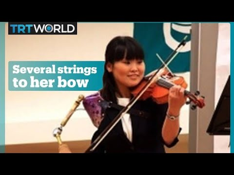 Japanese nurse plays violin with her prosthetic arm