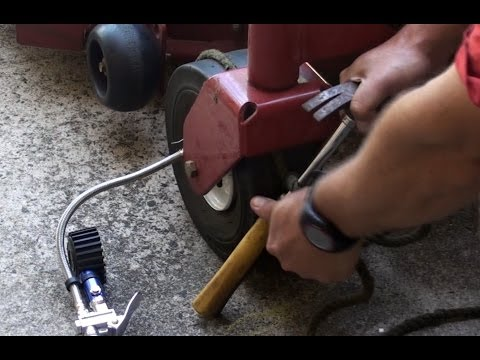 Inflate a front ride on mower tyre with broken bead without removing