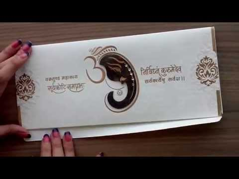 Hindu Wedding Card in Cream and Golden with Ganesha Design