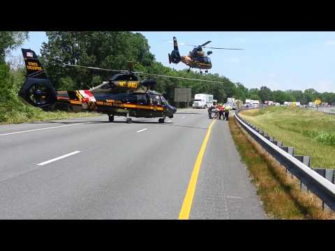 3 helicopters taking off from I-81 accident