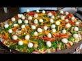 Paella caipira  no disco de arado (cozinha simples)