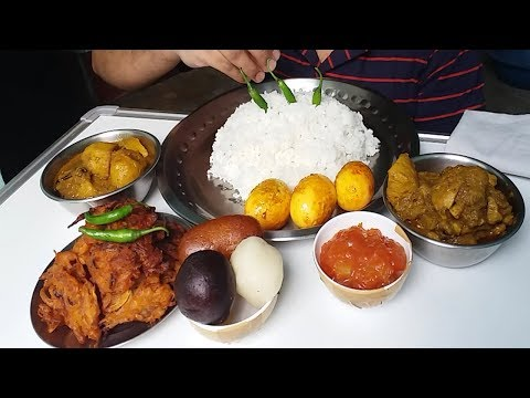 chicken curry and fried eggs eating with rice (spicy Indian food)