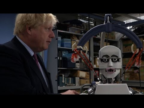 Britain's Johnson meets high-tech robots in Japan