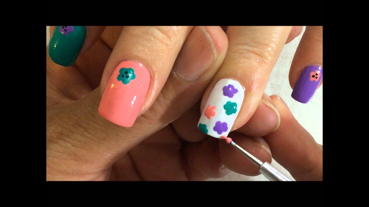 como realizar un decorado de uñas con flores de colores OLNAIL