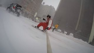 Watch This Daredevil Snowboard Through New York City Being Pulled by a Car
