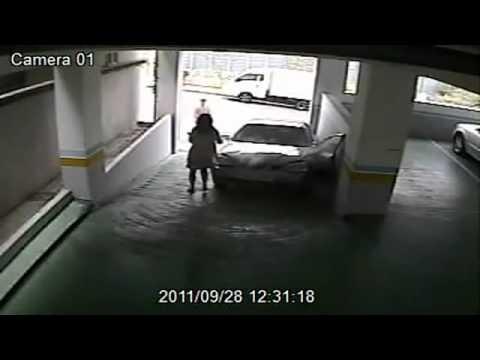 Woman entering parking garage fail