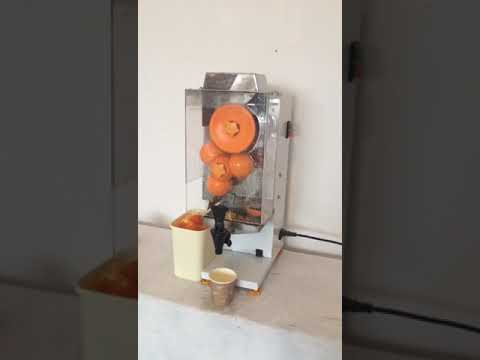 at home of coffee shop orange juice machine with tap