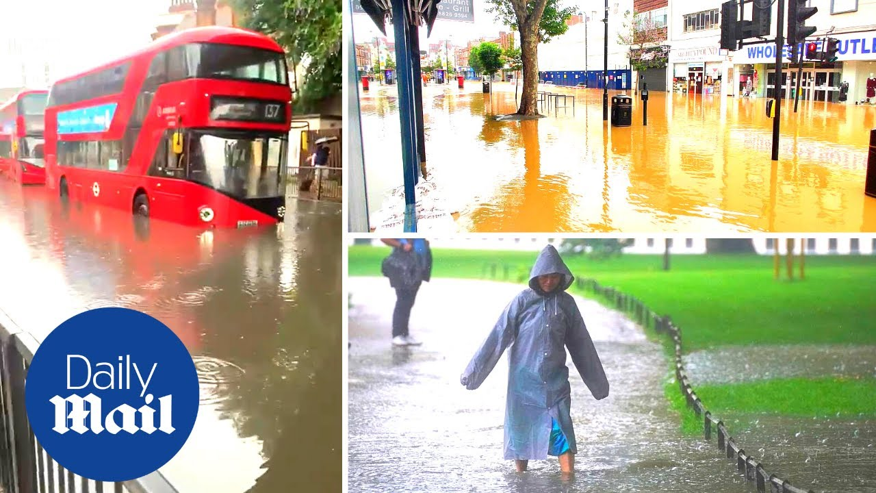 Download London floods: Chaos in capital after torrential rain causes havoc and flooding on streets