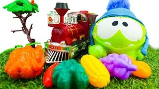Çizgi film oyuncakları - Om Nom trenle seyahat ediyor ve yemek arıyor. Eğlenceli çocuk oyunları!