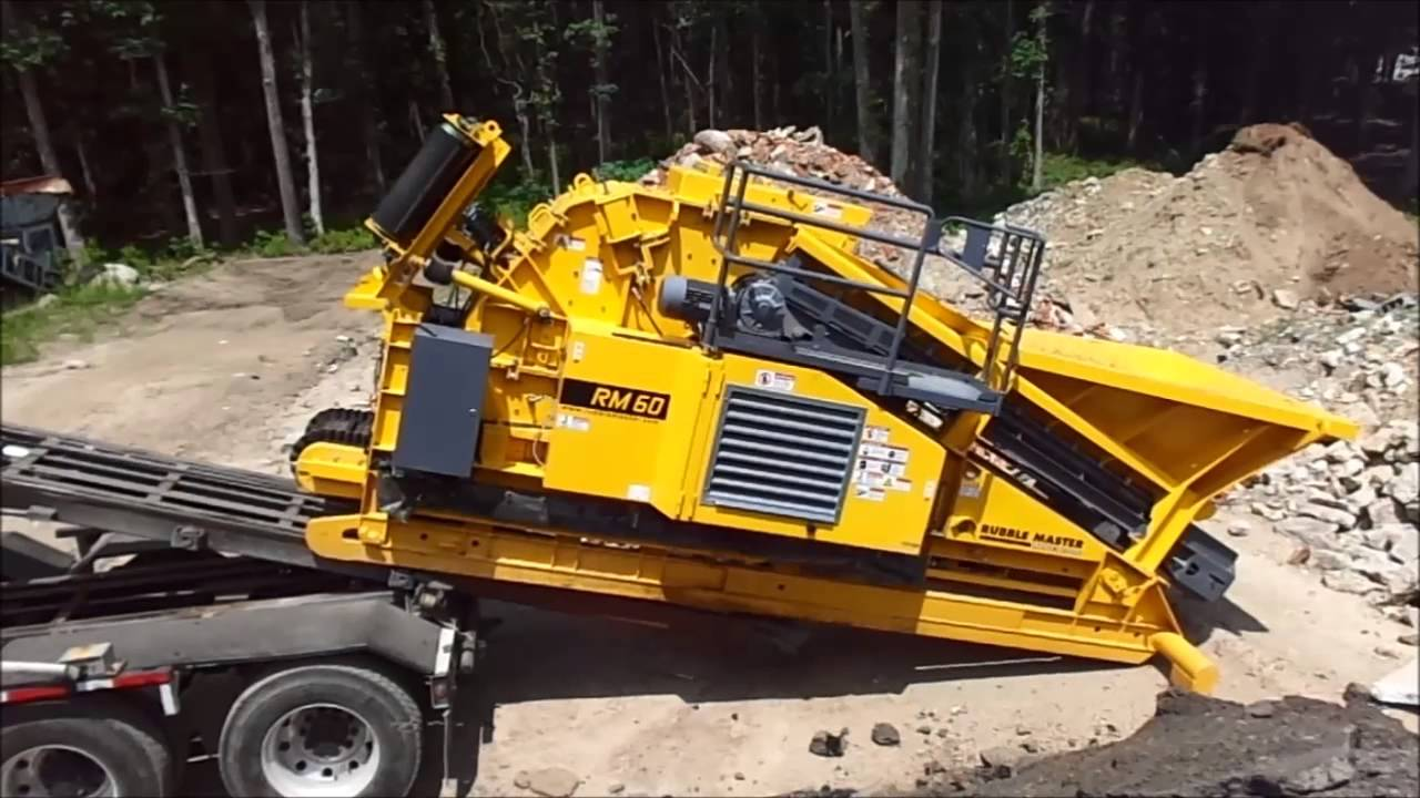 Unloading A Rm60 Compact Crusher From A Roll Off Truck