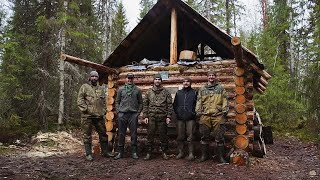 Build log cabin in taiga. Five men live in the taiga. Part II