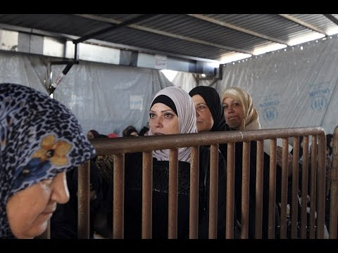 Syrian refugees settle en masse in Lebanon, overwhelming government