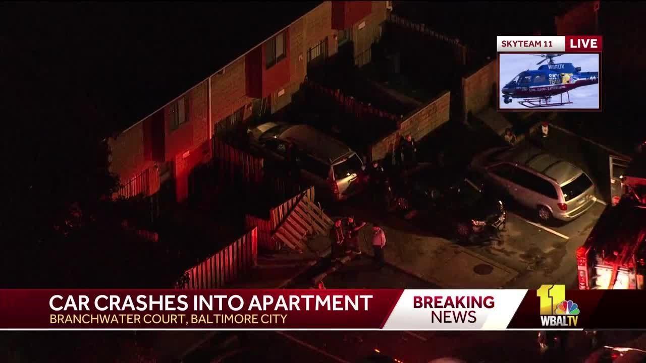 Car crashes into apartment in Baltimore City