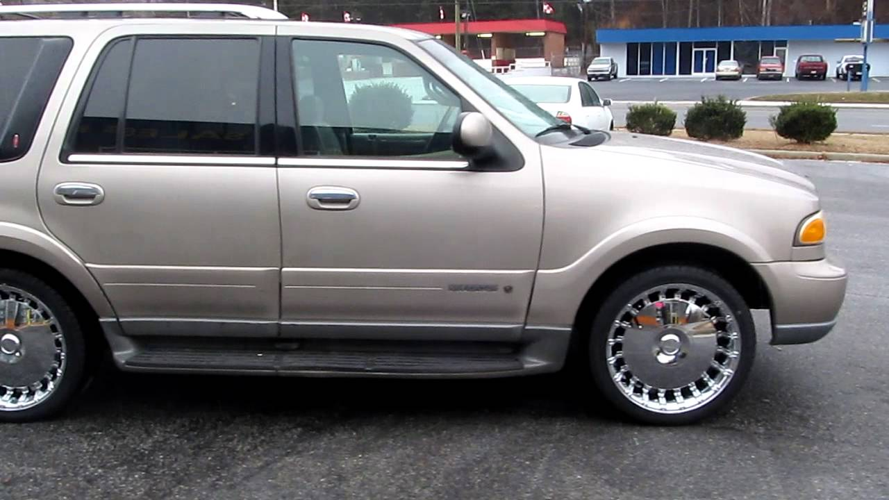 2002 lincoln navigator sitting on 22 player 667 rims wrapped in lexani 265 35 22 tires youtube 2002 lincoln navigator sitting on 22