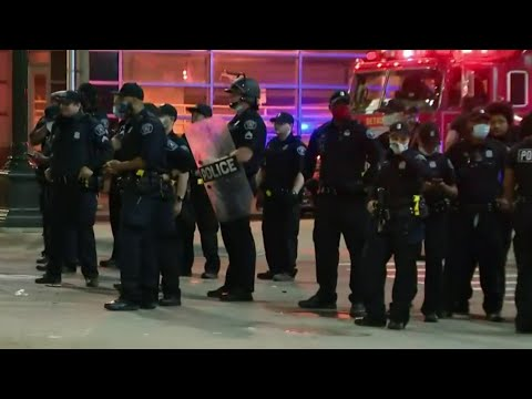 Group of protesters confront Detroit police