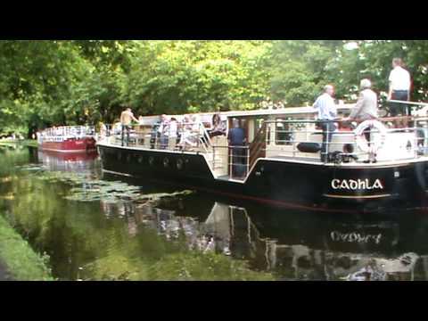 Barge MV Cadhla passes MvV Riasc La Peniche Grand Canal