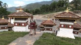 Elderly man walking upstairs in Dochula pass, Bhutan
