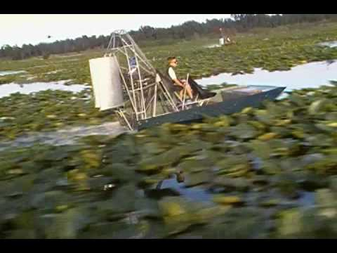 airboat races, mini racer with 8 year old driver,orange