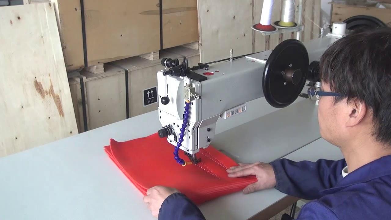 Máquina de coser industrial con triple arrastre y brazo