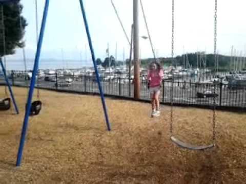 Emma Ginn @ HDG Playground jumping from Swing Set