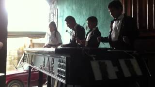 "La Escuela Nacional de Marimba plays ""Mi Bella Santa Ana"" on the Marimba"