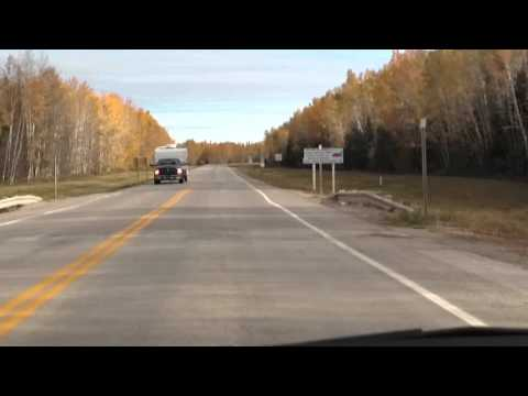 North of 60 on The Mackenzie Highway - Driving into Northwest Territories