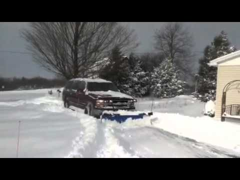 Chevy suburban snow plowing - YouTube