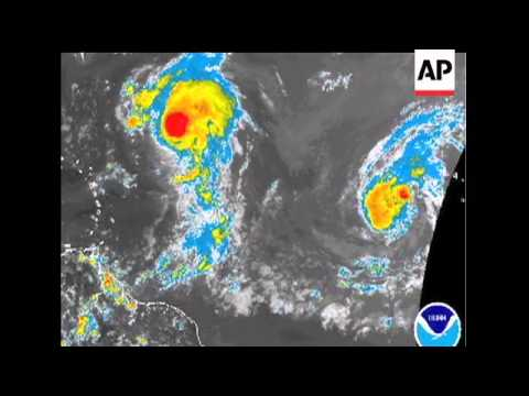 Forecasters at the National Hurricane Center in Miami are tracking twin storm systems in the Atlanti