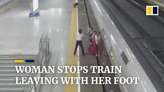 Woman in China stops train leaving with her foot