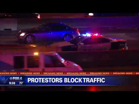Protesters march through Downtown Dallas demanding justice for Botham Jean