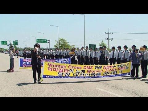 Peace activists make rare crossing of North-South Korea border