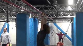 Alexander Graff working the floating cradle bars at Slingshot entertainment-Ninja Warrior