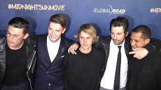 """Artist justin bieber showed support for his friend, patrick schwarzenegger by turning up on the """"midnight sun"""" red carpet in los angeles thursday (march 1..."""