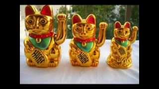 ¿Qué significa el gato chino que mueve el brazo?