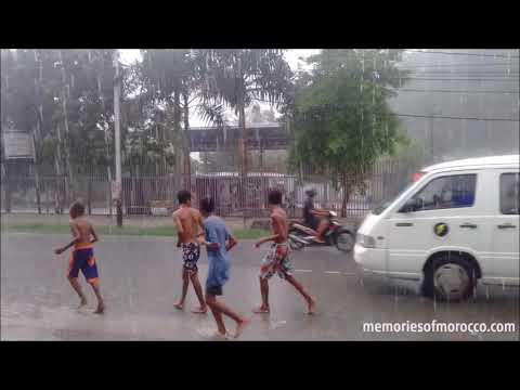 People in the heavy rain in Dili, Timor Leste / East Timor